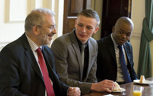 Sir Bob with Conor O'Connor and Kemet Hawthorn Pink, two Civil Service Fast Track Apprentices